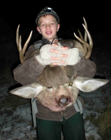 <h5>He's a Keeper!</br>(the kid and the buck!)</h5>