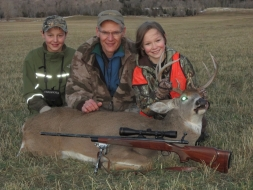 <h5>Katie w/ Dad, Mike</br>of Black Gold Bowsights</br>and Zander</h5>